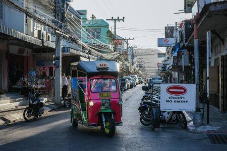 hua hin: Hua Hin, Thailand � March 1, 2013  A tuk tuk drives through a street in Hua Hin  Hua Hin is a major tourist destination in Thailand