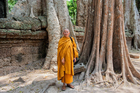 raider: Siem Reap, Cambodia � March 9, 2009  Buddhist monk posing at Ta Prohm  Built in 12-13th century Ta Prohm was later the location for the movie Tomb Raider   Editorial