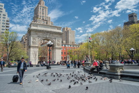 New York, USA � May 1, 2014  A sunny spring day in Washington Square Park � an iconic park and a center for cultural activity in Greenwich Village