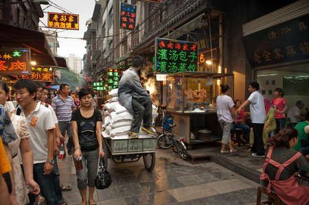 bustling: Xian, China - July 3, 2012  Bustling Muslim street in Xian  A lively market is run at Muslim Street by Hui people, a muslim ethnic minority in Xian   Editorial