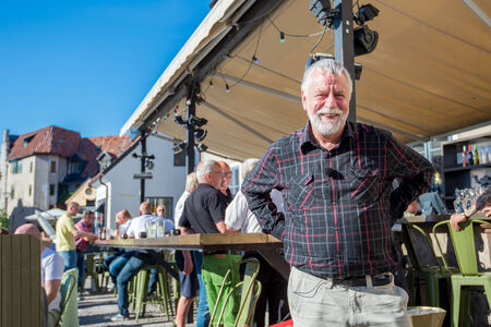 Visby, Sweden - June 10, 2014: Bjorn Hellberg after recording a TV show in medieval Visby. Bjorn Hellberg is a popular TV personality and a successful author of criminal novels.