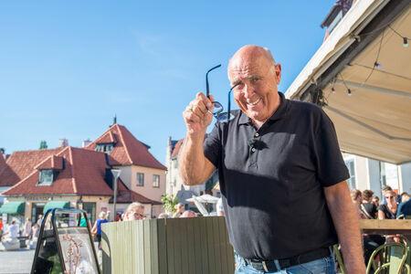 Visby, Sweden - June 10, 2014: Ingvar Oldsberg after recording a TV show in medieval Visby. Ingvar Oldsberg is one is Scandinavias most popular TV personalities.