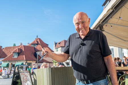 Visby, Sweden - June 10, 2014: Ingvar Oldsberg after recording a TV show in medieval Visby. Ingvar Oldsberg is one is Scandinavias most popular TV personalities. Editorial