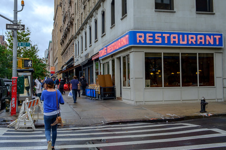 eatery: New York City, NY, USA - September 25, 2014: Pedestrians pass Tom?s Restaurant at 2880 Broadway on Manhattan. This site is famous as the location for Suzanne Vega?s Tom?s Diner and Seinfelds  Monk?s Caf