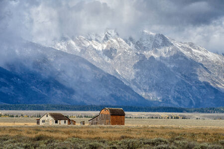 great plains: Dark clouds  over Mormon Row in Grand Teton National Park during autumn Stock Photo