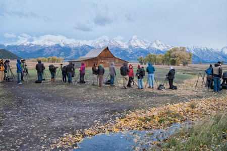 Grand Teton, WY, USA - October 2, 2014: Photographers gather to catch the sunrise at Mormon Row in Grand Teton on a chilly October morning.