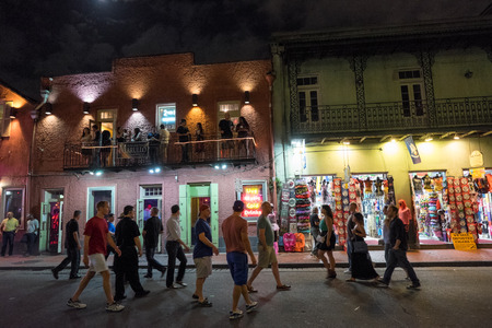 french quarter: New Orleans, LA, USA - October 9, 2014: Nightlife with tourists strolling along Bourbon Street in the French Quarter, New Orleans. Editorial