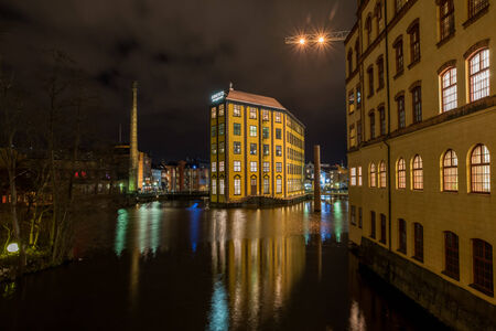 christmas atmosphere: Norrkoping, Sweden - December 8, 2014: Christmas atmosphere in the old industrial landscape of Norrkoping. The famous industrial landscape is illuminated during Christmas time and New Years Eve