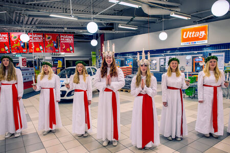 elected: Norrkoping, Sweden - December 13, 2014: The elected Saint Lucy of Norrkoping and its Danish sister town Odense with maids. Celebration of Saint Lucy is a typical Scandinavian tradition based on the Sicilian legend of Santa Lucia.