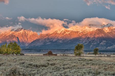 Sunrise at Mormon Row in Grand Teton National Park during autumn photo