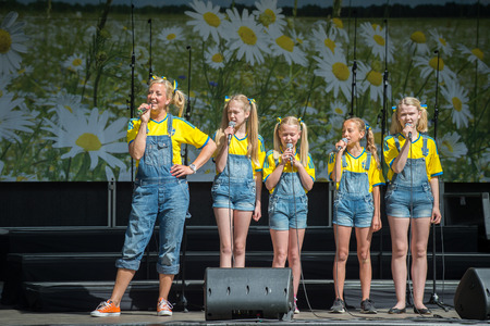 annually: Norrkoping, Sweden - June 6, 2014: Entertainment in the Olai Park during National day celebrations in Norrkoping. The national day of Sweden is celebrated on June 6 annually and is an official holiday. Editorial