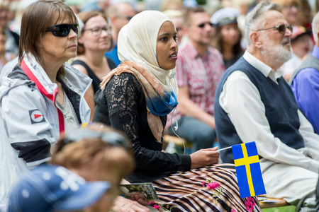 national day: Norrkoping, Sweden - June 6, 2014: Immigrants and native Swedes participating in National day celebrations in Norrkoping. The national day of Sweden is an official holiday. Editorial