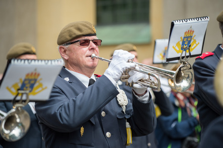 trumpet player: Norrkoping, Sweden - June 6, 2014: Male trumpet player in a military orchestra playing during National day celebrations in Norrkoping. The national day of Sweden is an official holiday.
