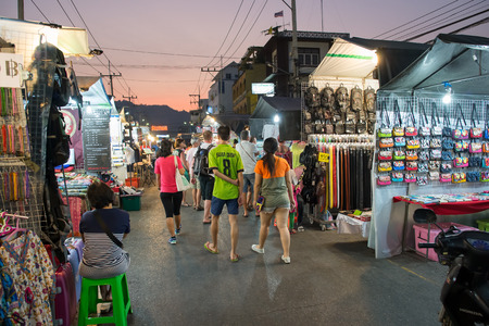 Hua Hin, Thailand - January 18, 2015: Tourists stroll at the night market in Hua Hin.  The famous night market in Hua Hin is a major tourist attraction. Редакционное