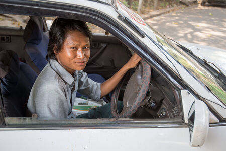 ethnically diverse: Yangon, Myanmar - February 10, 2014: Portrait of a Burmese taxi driver in Yangon. Myanmar is ethnically diverse with 51 million inhabitants belonging to 135 ethnic groups. Editorial