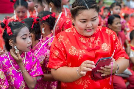 hua hin: Hua Hin, Thailand - February 18, 2015: Thai school girls celebrating Chinese New Year in Hua Hin. In Thailand New Year is celebrated on three occasions - the Gregorian, the Chinese and Songkran. Editorial