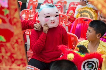 hua hin: Hua Hin, Thailand - February 18, 2015: Thai school boys celebrating Chinese New Year in Hua Hin. In Thailand New Year is celebrated on three occasions - the Gregorian, the Chinese and Songkran.