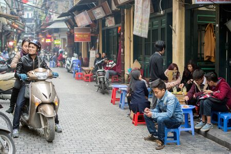 guilds: Hanoi, Vietnam - February 11, 2015: Street scene in the old quarter of Hanoi. The 36 old streets and guilds of the old quarter are a major tourist attraction.