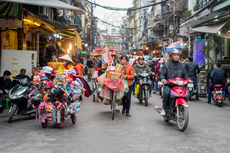 Hanoi, Vietnam - February 11, 2015: Busy traffic in the old quarter of Hanoi. There are approximately four million motorbikes on the streets of Hanoi. Редакционное