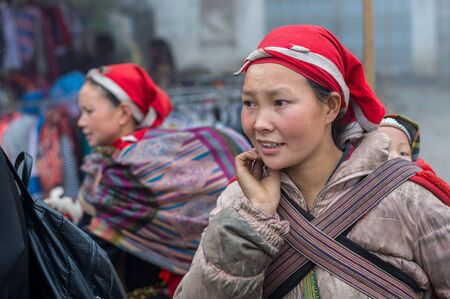famous women: Sapa, Vietnam - February 13, 2015: Red Dao women in a village outside Sapa. Sapa is famous for its rugged scenery and its rich cultural diversity. Red Dao people is one of many a colorful tribes.