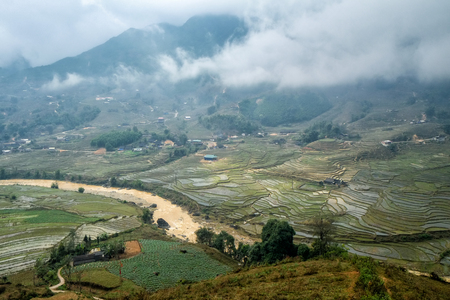 sapa: Rice terraces on a rainy and foggy day outside Sapa in the Lao Cai province of Vietnam. Sapa is famous for its rugged scenery and its rich cultural diversity.