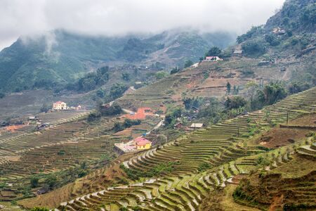 sapa: Rice terraces on a rainy and foggy day outside Sapa in the Lao Cai province of Vietnam. Sapa is famous for its rugged scenery and its cultural diversity. Stock Photo