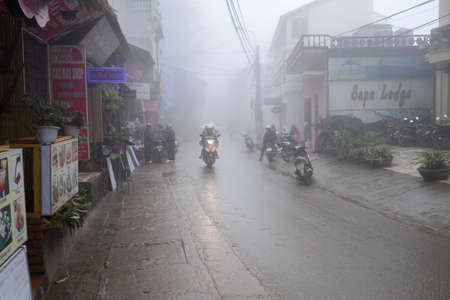 cultural diversity: Sapa, Vietnam - February 13, 2015: Scene from a misty day in Sapa. Sapa is famous for its rugged scenery and its cultural diversity.