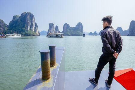 tour boats: Halong Bay, Vietnam - February 16, 2015: Tour boats cruise in Halong Bay. With its 1600 islands and islets Hanlong Bay is a Unesco World Heritage site and a major tourist destination in northern Vietnam. Editorial