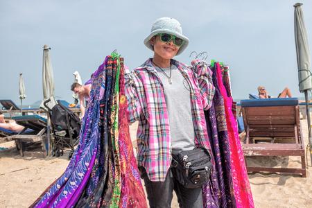 hin hua: Hua Hin, Thailand - January 23, 2014: Young Thai woman selling clothes at Sai Noi Beach in Khao Tao outside Hua Hin.  Hua Hin is a major tourist destination in Thailand.
