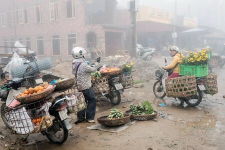cultural diversity: Sapa, Vietnam - February 13, 2015: Scene from a misty day at the market in Sapa. Sapa is famous for its rugged scenery and its rich cultural diversity.