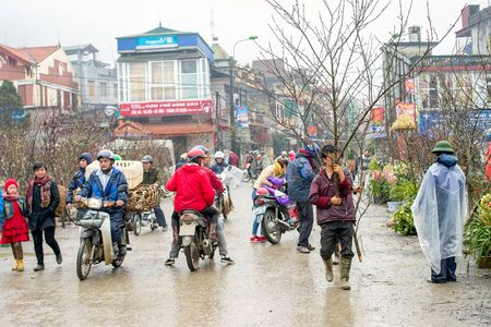 cultural diversity: Sapa, Vietnam - February 13, 2015: Scene from a misty day at the market in Sapa. Sapa is famous for its rugged scenery and its cultural diversity.