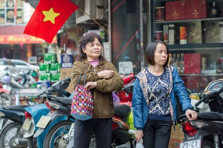 guilds: Hanoi, Vietnam - February 15, 2015: Street scene in the old quarter of Hanoi. The 36 old streets and guilds of the old quarter are a major tourist attraction.