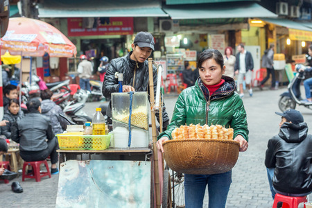 guilds: Hanoi, Vietnam - February 11, 2015: Street food for sale in the old quarter of Hanoi. The 36 old streets and guilds of the old quarter are a major tourist attraction. Editorial