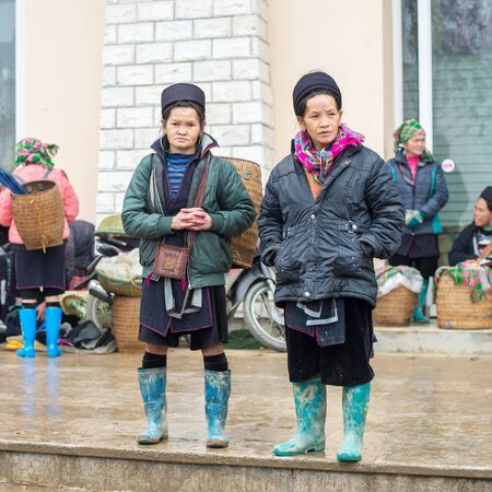 cultural diversity: Sapa, Vietnam - February 13, 2015: Hmong women at a market in Sapa. Sapa is famous for its rugged scenery and its cultural diversity. Hmong people are one of many colorful tribes. Editorial