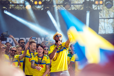 Stockholm, Sweden  July 1, 2015: Kaliffa raps for Swedish players who won the countrys first UEFA European Under-21 Championship title as the team enjoys public celebration on returning back to Sweden. Redactioneel
