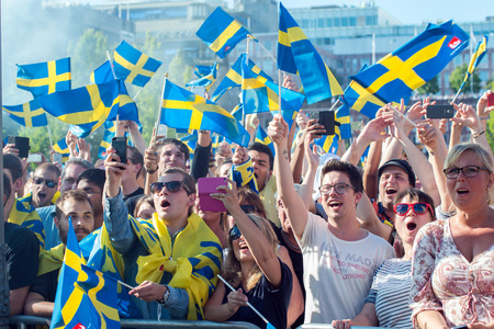 Stockholm, Sweden  July 1, 2015: Thousands of Swedish football fans welcome back the Sweden players who won the countrys first UEFA European Under-21 Championship title.
