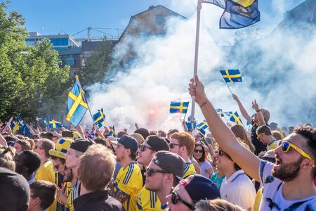 football fans: Stockholm, Sweden  July 1, 2015: Thousands of Swedish football fans welcome back the Sweden players who won the countrys first UEFA European Under-21 Championship title.