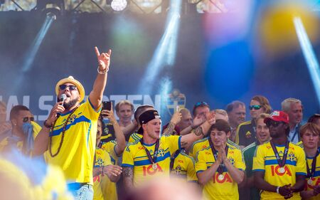 football fans: Stockholm, Sweden  July 1, 2015: Kaliffa entertains as thousands of Swedish football fans welcome back the Sweden players who won the countrys first UEFA European Under-21 Championship title. Editorial