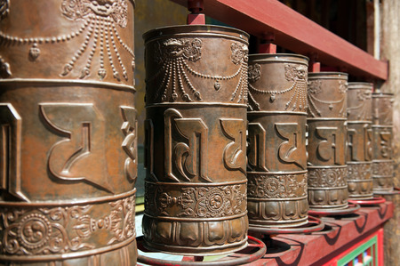 dalai: Qinghai Province, China  June 25, 2012: Prayer wheels at Kumbum Monastery. This Tibetan Buddhist monastery founded by the third Dalai Lama in 1583 ranks second only to Lhasa in importance.