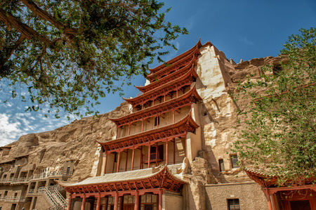 Dunghuan, China  June 27, 2012: The famous Mogao caves at the Silk road in Dunhuang. Hundreds of caves display some of the finest Buddhist art spanning over 1000 years. Editorial