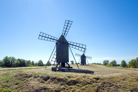 nicknamed: Traditional windmills on Swedish island Oland in the Baltic Sea. Windmills are a common sight on Oland, which is nicknamed the island of the sun and winds.