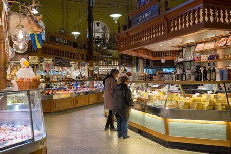 market hall: Stockholm Sweden - November 10 2014: Ostermalm market hall in Stockholm. The famous Ostermalm market hall was opened in 1888.