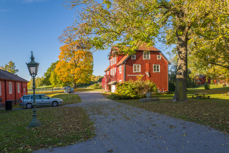 18th: Norrkoping, Sweden  October 16, 2015: The museum of Bronze Age rock carvings during autumn in Himmelstalund, Norrkoping. The old traditional building from 18th century was formerly an old spa, which people visited to drink from its well for medical reason