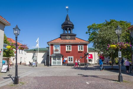 tourist destination: Trosa, Sweden  August 19, 2015: The old city hall in Trosa. Trosa is an idyllic and historic seaside town south of Stockholm and a popular tourist destination during summer time. Editorial