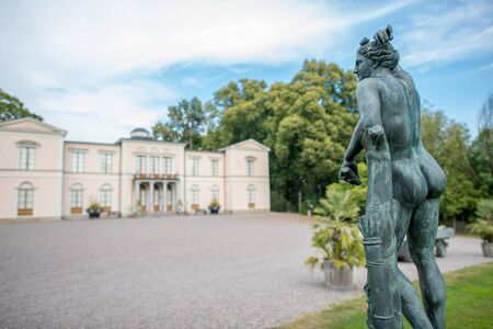 retreat: Stockholm, Sweden  August 24, 2015: Statue of Apollo at Rosendal Palace at Djurgarden in Stockholm. The palace was built in the 1820s for the first Bernadotte king as a summertime pleasure retreat.