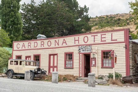 gold rush: Cardrona, New Zealand - February 13, 2012: Vintage Cardrona Hotel in scenic Cardrona, Central Otago. Cardrona was established during the gold rush in the 1860s.