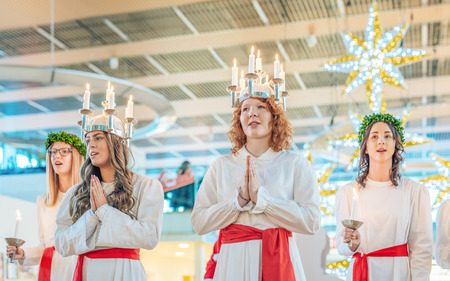 dearest: Norrkoping, Sweden - December 13, 2015: Lucia celebration in Norrkoping. The celebration of Lucia or Saint Lucy is one of the dearest traditions in Sweden before Christmas. Editorial