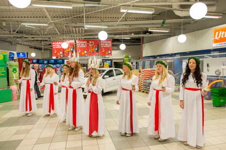 dearest: Norrkoping, Sweden - December 13, 2014: Lucia celebration in a mall in Norrkoping. The celebration of Lucia or Saint Lucy is one of the dearest traditions in Sweden before Christmas.