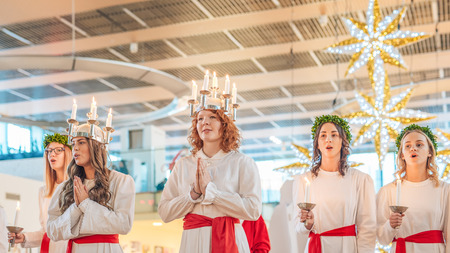 christmas carols: Norrkoping, Sweden - December 13, 2015: Lucia celebration in Norrkoping. The celebration of Lucia or Saint Lucy is one of the dearest traditions in Sweden before Christmas. Editorial