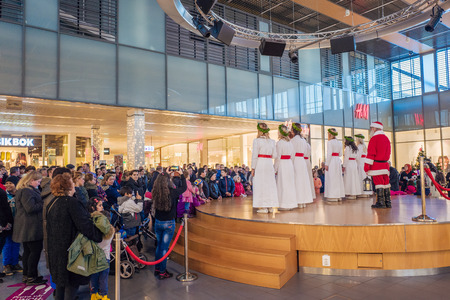 dearest: Norrkoping, Sweden - December 13, 2015: Lucia celebration in a mall in Norrkoping. The celebration of Lucia or Saint Lucy is one of the dearest traditions in Sweden before Christmas.